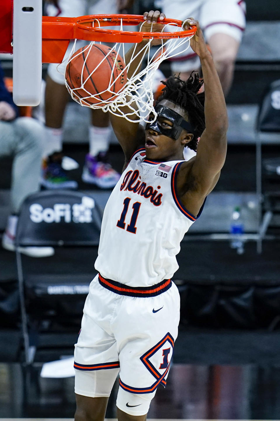 FILE - Illinois guard Ayo Dosunmu (11) dunks against Iowa in the second half of an NCAA college basketball game at the Big Ten Conference tournament in Indianapolis, in this Saturday, March 13, 2021, file photo. Dosunmu has made The Associated Press All-America first team, announced Tuesday, March 16, 2021. (AP Photo/Michael Conroy, File)