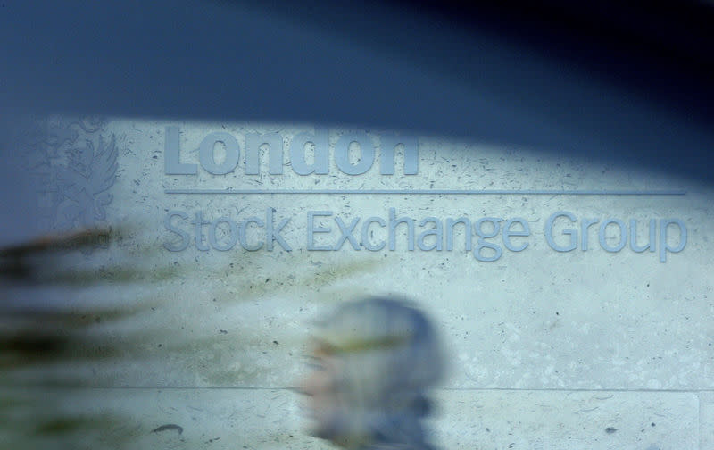 FILE PHOTO: A woman is seen through a car window as she walks past the London Stock Exchange