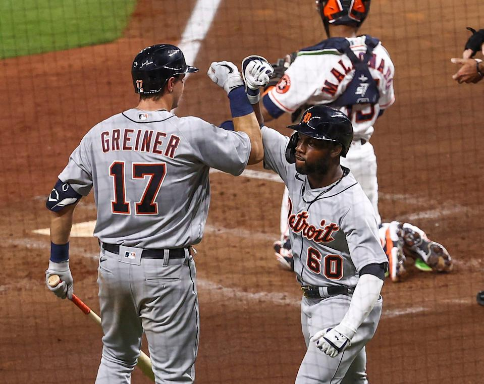 Detroit Tigers center fielder Akil Baddoo (60) celebrates with catcher Grayson Greiner (17) after hitting a home run during the third inning against the Houston Astros April 12, 2021 at Minute Maid Park.