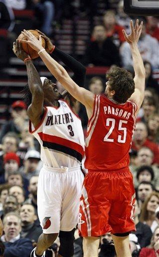 Portland Trail Blazers' Gerald Wallace (3) shoots against Houston Rockets' Chandler Parsons (25) during the first quarter of an NBA basketball game Wednesday, Feb. 8, 2012, in Portland, Ore. (AP Photo/Rick Bowmer)