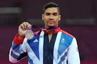 Louis Smith of Great Britain celebrates with his silver medal during the medal ceremony following the Artistic Gymnastics Men's Pommel Horse final on Day 9 of the London 2012 Olympic Games at North Greenwich Arena on August 5, 2012 in London, England. (Photo by Quinn Rooney/Getty Images)