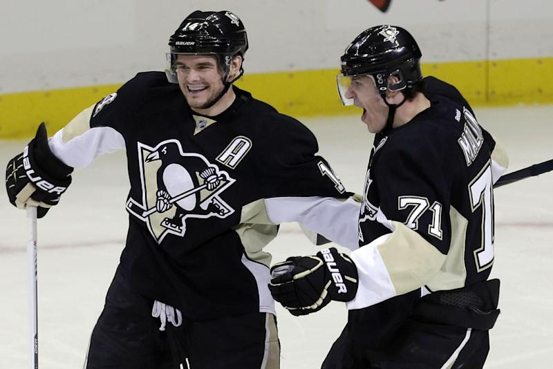 Pittsburgh Penguins' Evgeni Malkin (71) celebrates with Pittsburgh Penguins' Chris Kunitz (14) after scoring in the first period of Game 1 of an NHL hockey Stanley Cup second-round playoff series against the Ottawa Senators in Pittsburgh, Tuesday, May 14, 2013. (AP Photo/Gene J. Puskar)