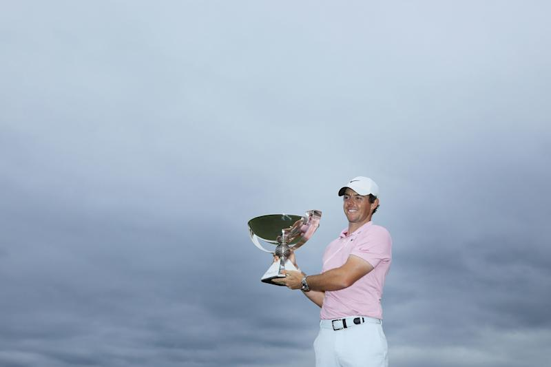 Rory McIlroy celebrates with the FedExCup trophy after winning during the final round of the 2019 Tour Championship.