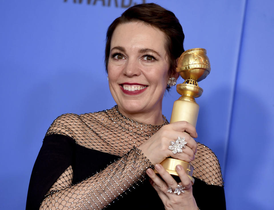 """Olivia Colman poses in the press room with the award for best performance by an actress in a motion picture, musical or comedy for """"The Favourite"""" at the 76th annual Golden Globe Awards at the Beverly Hilton Hotel on Sunday, Jan. 6, 2019, in Beverly Hills, Calif. (Photo by Jordan Strauss/Invision/AP)"""
