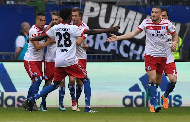 Soccer Football - Bundesliga - Hamburger SV v Borussia Moenchengladbach - Volksparkstadion, Hamburg, Germany - May 12, 2018 Hamburg's Aaron Hunt celebrates scoring their first goal with Gideon Jung and team mates REUTERS/Fabian Bimmer DFL RULES TO LIMIT THE ONLINE USAGE DURING MATCH TIME TO 15 PICTURES PER GAME. IMAGE SEQUENCES TO SIMULATE VIDEO IS NOT ALLOWED AT ANY TIME. FOR FURTHER QUERIES PLEASE CONTACT DFL DIRECTLY AT + 49 69 650050