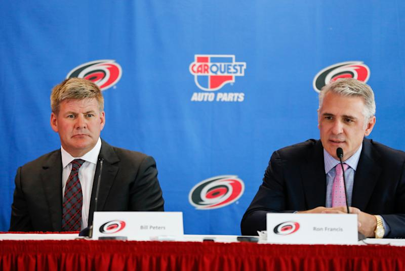New Carolina Hurricanes head coach Bill Peters and Hurricanes general manager Ron Francis speak to the media during a press conference at PNC Arena in Raleigh, N.C., Friday, June 20, 2014. (Jill Knight/Raleigh News & Observer/Tribune News Service via Getty Images)