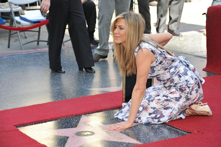 """<p>Aniston was honored with a star on the <a href=""""http://www.walkoffame.com/jennifer-aniston"""" rel=""""nofollow noopener"""" target=""""_blank"""" data-ylk=""""slk:Hollywood Walk of Fame"""" class=""""link rapid-noclick-resp"""">Hollywood Walk of Fame</a> in 2012. Adam Sandler, Malin Akerman, and longtime friend, Kathryn Hahn, were there to help her celebrate.</p>"""