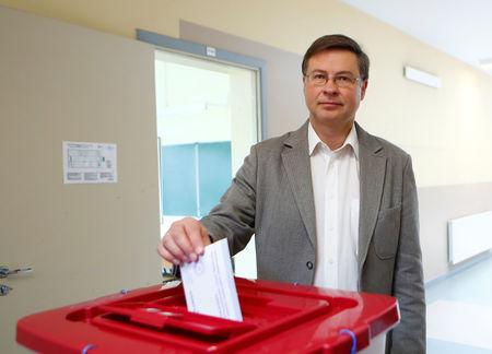 European Commission Vice-President for the Euro and Social Dialogue Valdis Dombrovskis casts his vote during European Parliament election in Riga, Latvia, May 25, 2019. REUTERS/Ints Kalnins