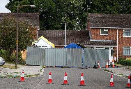 A barrier and a police tent stand outside Sergei Skripal's home in Salisbury Britain