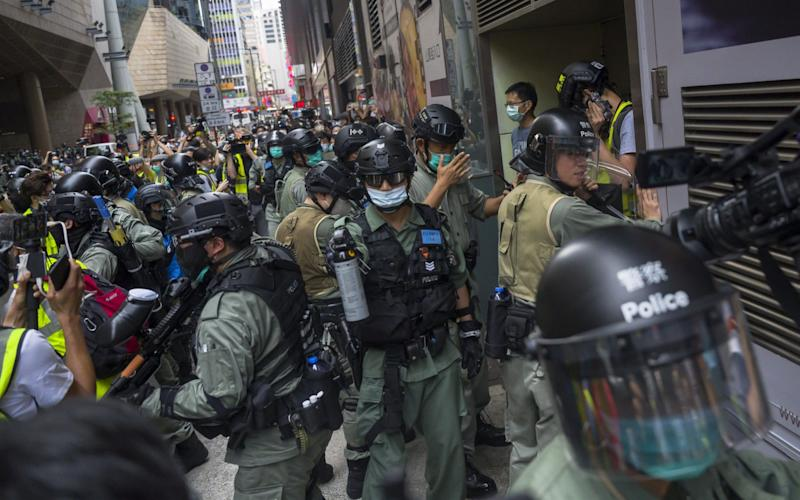 Riot police gather to disperse protesters - Getty Images