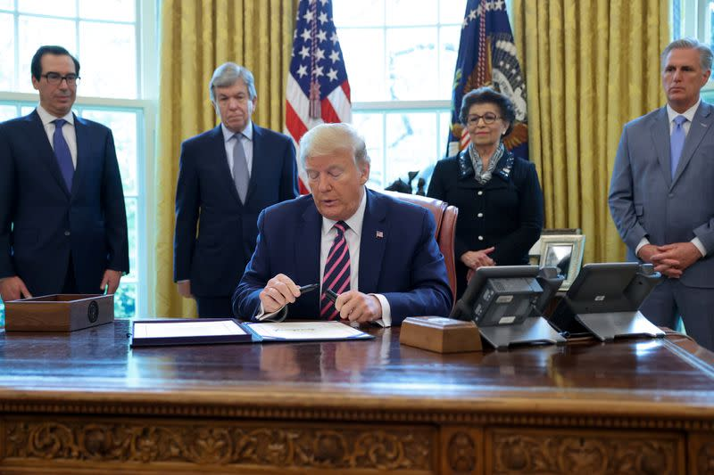 U.S. President Trump signs the Paycheck Protection Program and Health Care Enhancement Act response to the coronavirus disease outbreak at the White House in Washington