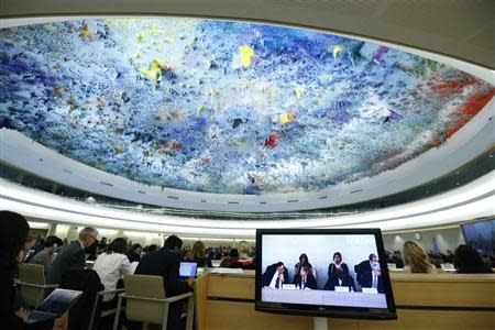 Delegates and representatives listen during the Human Rights Council Universal Periodic Review session of Israel at the European headquarters of the United Nations in Geneva October 29, 2013. REUTERS/Denis Balibouse