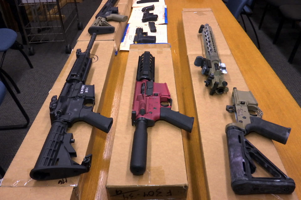 """FILE - This Nov. 27, 2019, file photo shows """"ghost guns"""" on display at the headquarters of the San Francisco Police Department in San Francisco. A federal appeals court in San Francisco has ruled that plans for 3D-printed, self-assembled """"ghost guns"""" can be posted online without U.S. State Department approval. The San Francisco Chronicle says the 2-1 decision was made Tuesday, April 27, 2021, by the 9th U.S. District Court of Appeals. (AP Photo/Haven Daley, File)"""