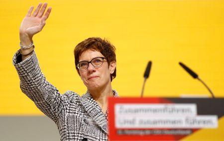 Annegret Kramp-Karrenbauer waves after being elected as the party leader during the Christian Democratic Union (CDU) party congress in Hamburg, Germany, December 7, 2018. REUTERS/Kai Pfaffenbach