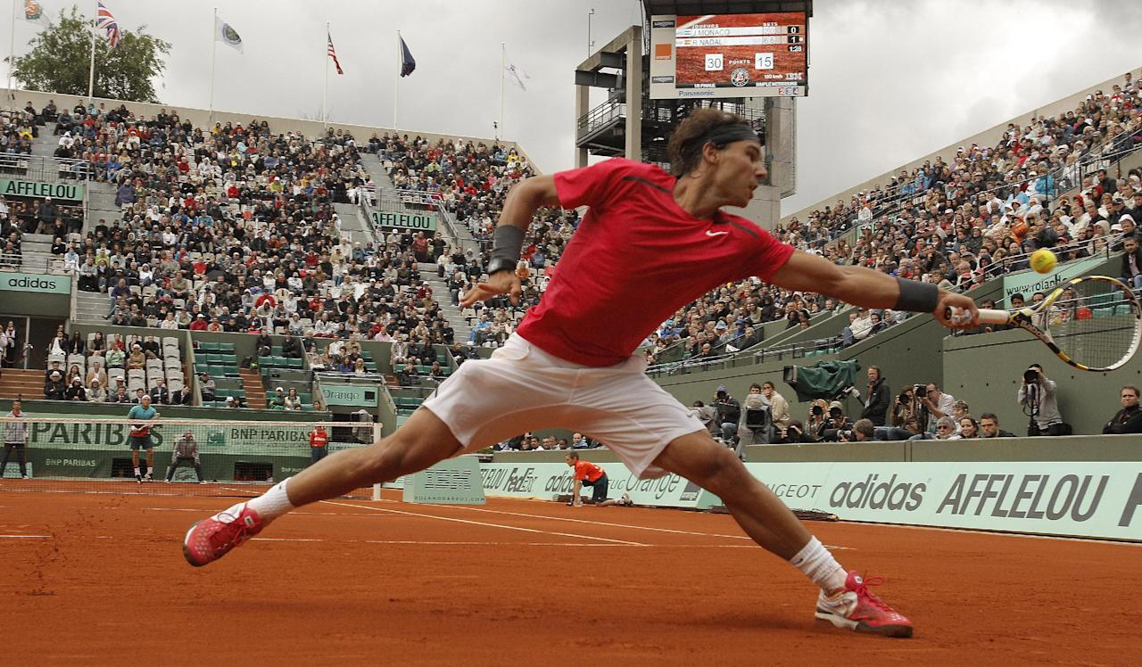 Spain's Rafael Nadal returns the ball to Argentina's Juan Monaco in their fourth round match in the French Open tennis tournament at the Roland Garros stadium in Paris, Monday, June 4, 2012. Nadal won 6-2, 6-0, 6-0. (AP Photo/Michel Spingler)