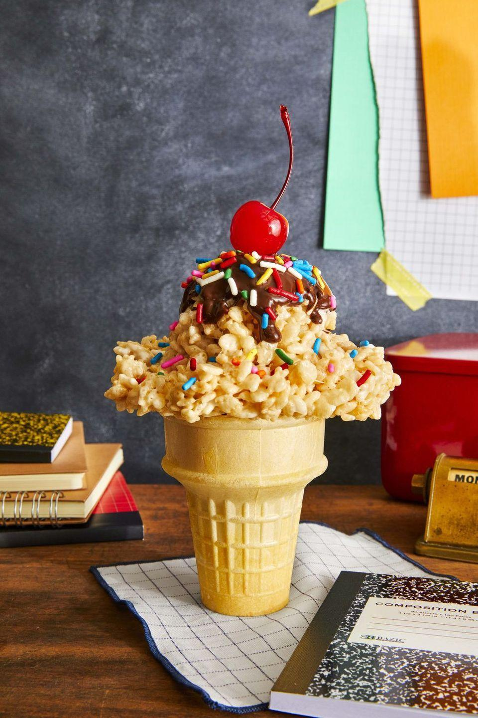 """<p>Pile Rice Krispies treats into ice cream cones for sweet, fake-out dessert!</p><p><em><a href=""""https://www.countryliving.com/food-drinks/a33553753/cereal-ice-cream-cones/"""" rel=""""nofollow noopener"""" target=""""_blank"""" data-ylk=""""slk:Get the recipe from Country Living »"""" class=""""link rapid-noclick-resp"""">Get the recipe from Country Living »</a></em></p>"""