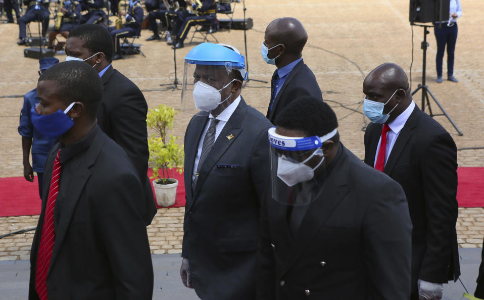 Zimbabwean Deputy President Constantino Chiwenga, centre, arrives to officiate at the burial of three top government officials at the National Heroes Acre in Harare, Wednesday, Jan. 27, 2021. Zimbabwe on Wednesday buried three top officials who succumbed to COVID-19, in a single ceremony at a shrine reserved almost exclusively for the ruling elite as a virulent second wave of the coronavirus takes a devastating toll on the country. (AP Photo/Tsvangirayi Mukwazhi)