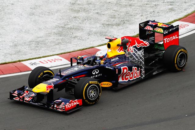 MONTREAL, CANADA - JUNE 08: Sebastian Vettel of Germany and Red Bull Racing drives with attachment seen on his car during his installation lap in practice for the Canadian Formula One Grand Prix at the Circuit Gilles Villeneuve on June 8, 2012 in Montreal, Canada. (Photo by Paul Gilham/Getty Images)