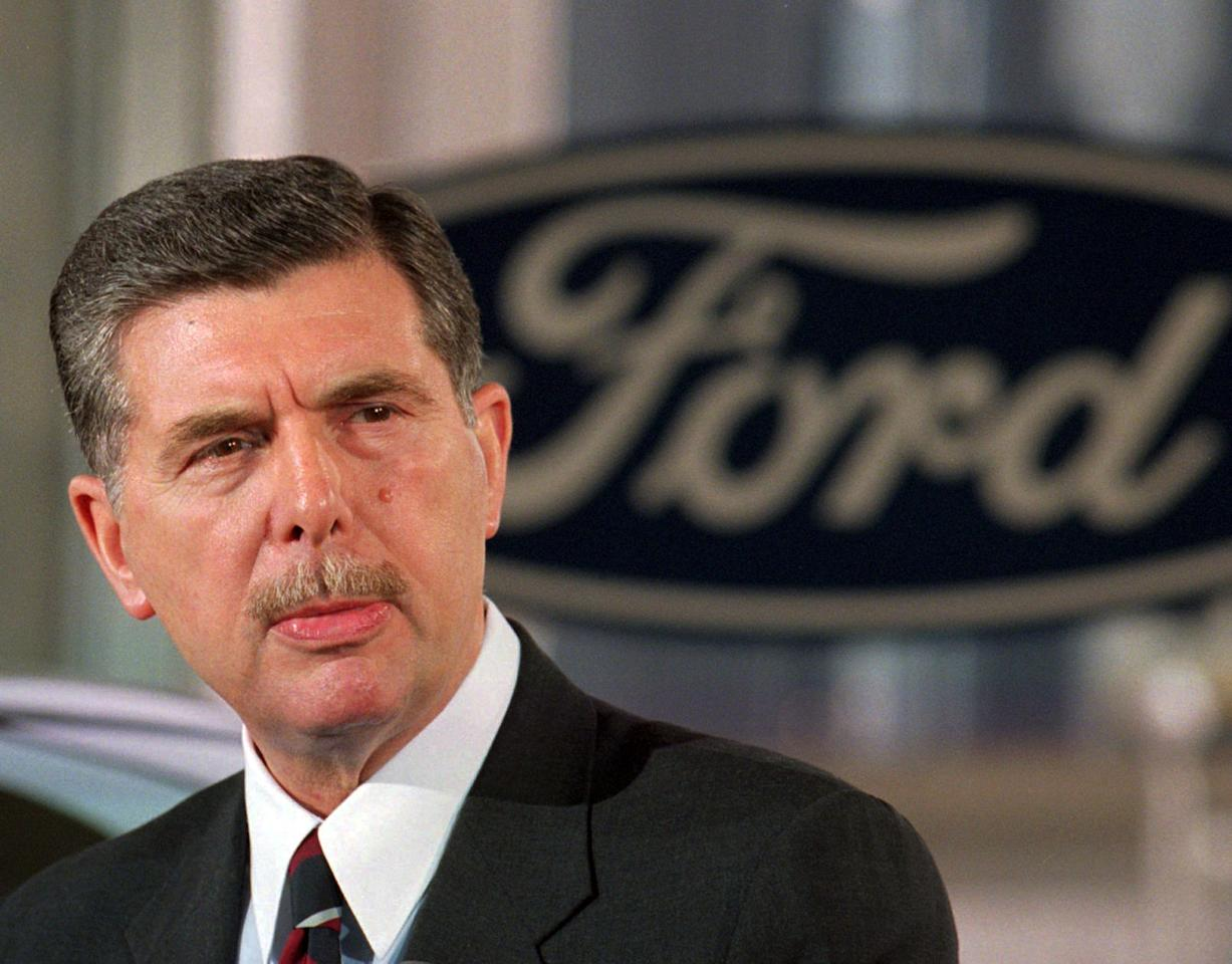 FILE - In this Sept. 16, 1996, file photo, Ford Motor Co. Chairman Alex Trotman appears at a news conference at the Economic Club of Detroit luncheon in Detroit. Born in the U.K., Trotman held numerous positions at Ford before he became its first foreign-born CEO in the early 1990s. Trotman's biggest contribution to the company as CEO was an attempt to move Ford's various brands worldwide to start sharing parts and platforms to help lower production costs. Ford named Jim Hackett its 10th CEO Monday, May 22, 2017. (AP Photo/Tom Pidgeon, File)