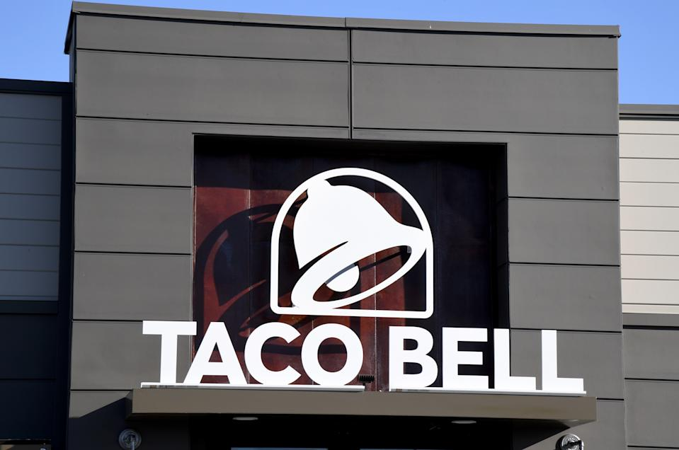 """LAS VEGAS, NEVADA - MARCH 30:  An exterior view shows a sign at a Taco Bell restaurant on March 30, 2020 in Las Vegas, Nevada. Taco Bell Corp. announced that on March 31, 2020, the company will give everyone in the country one free beef nacho cheese Doritos Locos Taco, no purchase necessary, to drive-thru customers at participating locations while supplies last as a way of thanking people who are helping their communities in the wake of the coronavirus pandemic. The company also announced it would relaunch its Round Up program, which gives customers the option to """"round up"""" their order total to the nearest dollar, to raise funds for the No Kid Hungry campaign. The Taco Bell Foundation will also be donating $1 million to the campaign.  (Photo by Ethan Miller/Getty Images)"""