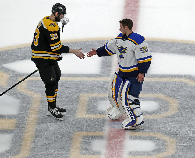 "Bruins captain Zdeno Chara (left) and Blues goalie Jordan Binnington (right) got he hand shake line going on the spoked ""B"" at center ice follwing St. Louis' win. The Boston Bruins host the St. Louis Blues in Game 7 of the 2019 Stanley Cup Final at TD Garden. (Jim Davis/Globe Staff)"