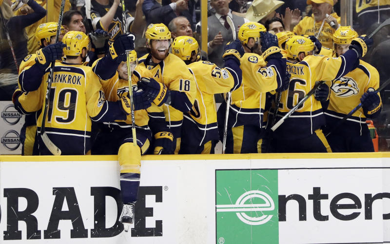 Nashville Predators players celebrate after a goal against the Chicago Blackhawks during the third period in Game 4 of a first-round NHL hockey playoff series Thursday, April 20, 2017, in Nashville, Tenn. (AP Photo/Mark Humphrey)