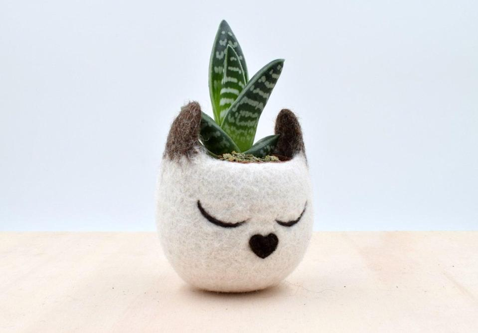 <p>A handmade <span>cat succulent planter</span> ($25) is just what your feline-loving friend needs.</p>