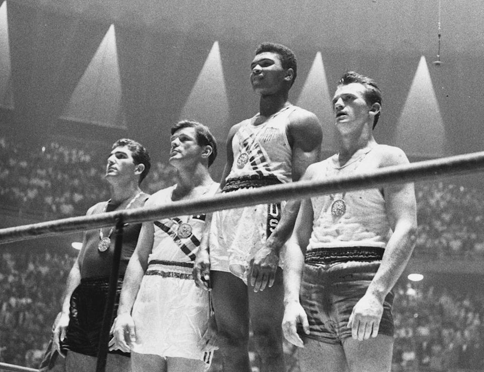 Muhammad Ali at the medal ceremony after he won the gold medal in the light-heavyweight division. (PHOTO: Central Press/Getty Images)