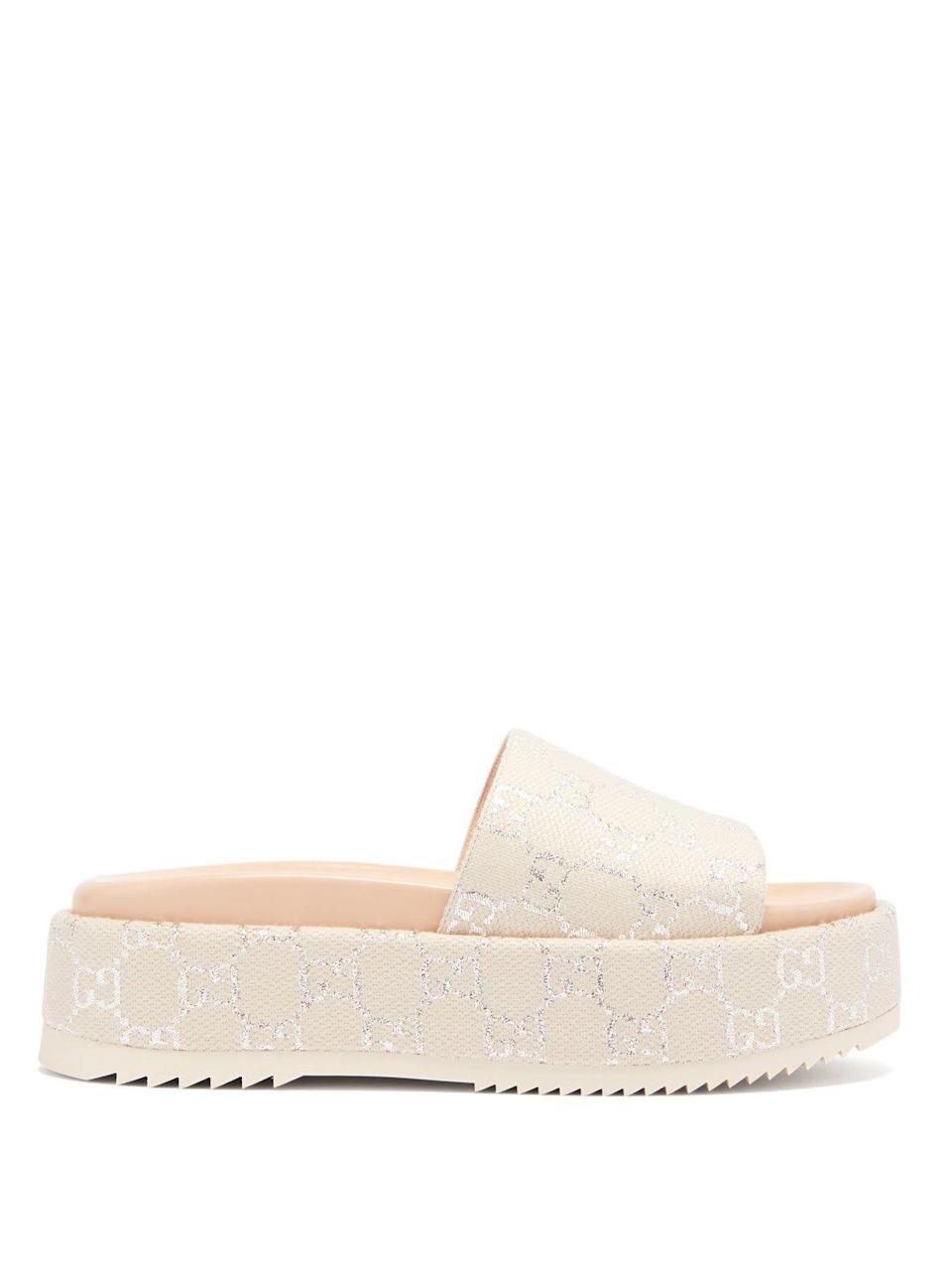 """<p><strong>Gucci</strong></p><p>matchesfashion.com</p><p><strong>$595.00</strong></p><p><a href=""""https://go.redirectingat.com?id=74968X1596630&url=https%3A%2F%2Fwww.matchesfashion.com%2Fus%2Fproducts%2F1360977&sref=https%3A%2F%2Fwww.harpersbazaar.com%2Fwedding%2Fbridal-fashion%2Fg36113322%2Fwedding-flats-for-brides%2F"""" rel=""""nofollow noopener"""" target=""""_blank"""" data-ylk=""""slk:SHOP NOW"""" class=""""link rapid-noclick-resp"""">SHOP NOW</a></p><p>Go for a jacquard flat-form slide to get some extra height and a little fashion girl glamour, without any discomfort. </p>"""