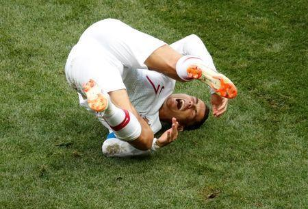 Soccer Football - World Cup - Group B - Portugal vs Morocco - Luzhniki Stadium, Moscow, Russia - June 20, 2018 Portugal's Cristiano Ronaldo reacts after a challenge REUTERS/Christian Hartmann