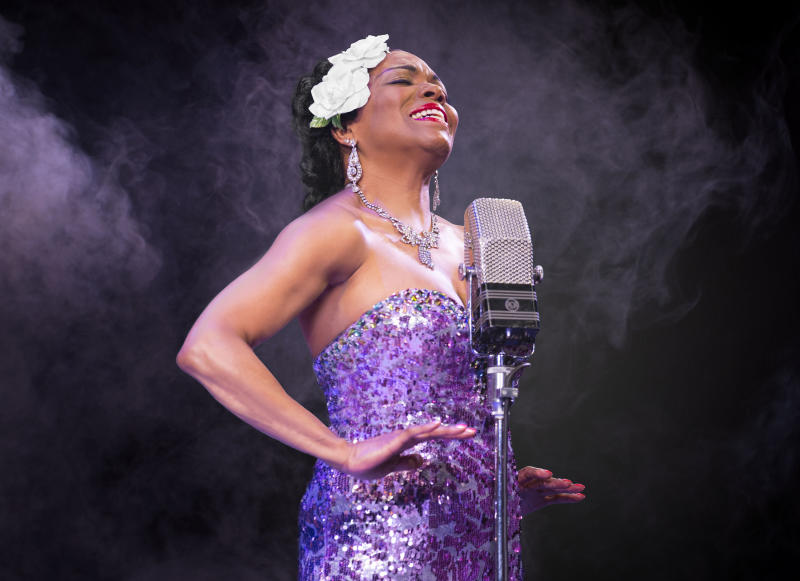 """This image released by Cromarty and Co. shows Dee Dee Bridgewater performing in the off-Broadway musical play, """"Lady Day,"""" about legendary jazz singer Billie Holiday. The role not only involves more than 25 musical production numbers but also 16 monologues, or """"regressions,"""" that look at the brilliant singer's troubled life. (AP Photo/Cromarty and Co., Carol Rosegg)"""