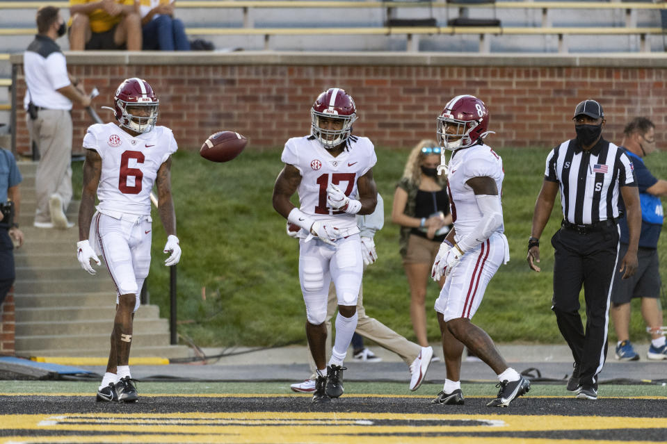 Alabama wide receiver Jaylen Waddle, center, celebrates with teammates DeVonta Smith, left, and John Metchie III, right, after scoring a TD against Missouri on Sept. 26. (AP)