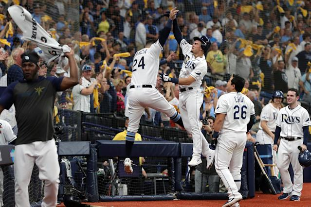 Willy Adames of the Tampa Bay Rays celebrates with teammate Avisail Garcia in ALDS Game 4. (Getty Images)