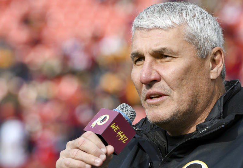 LANDOVER, MD - NOVEMBER 18: Former Washington Redskins quarterback Mark Rypien speaks to the crowd during a Redskins recognition ceremony prior to the game on November 18, 2018, at FedEx Field in Landover, MD. (Photo by Mark Goldman/Icon Sportswire via Getty Images)