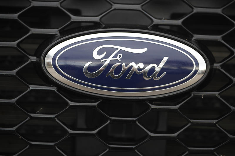 In this Sunday, Oct. 20, 2019, photograph, the company logo shones off the mesh grille of an unsold 2019 Edge ST sports-utility vehicle at a Ford dealership in Littleton, Colo. (AP Photo/David Zalubowski)