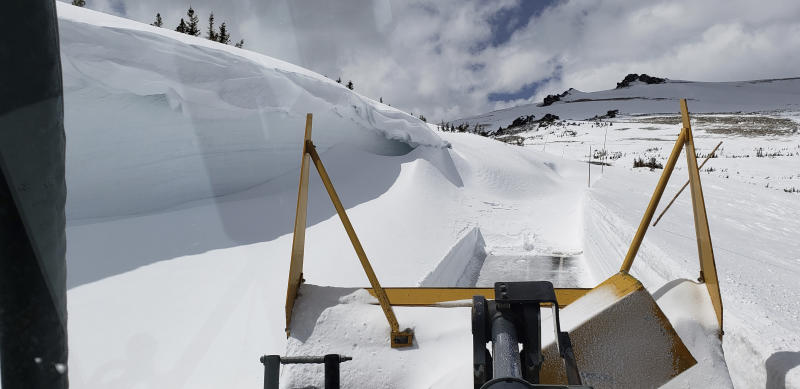This May 1, 2019, photo provided by the National Park Service shows a snowplow clearing a 19-foot drift on Trail Ridge Road in Rocky Mountain National Park, Colo. This section of the road had been cleared previously but a spring storm dropped more snow, requiring crews to plow it again. Heavy winter snow and a cold, wet May in the Rocky Mountains are sending a welcome surge of spring runoff into the rivers of the Southwestern U.S., fending off a water shortage but threatening to push some streams over their banks. (National Park Service via AP)