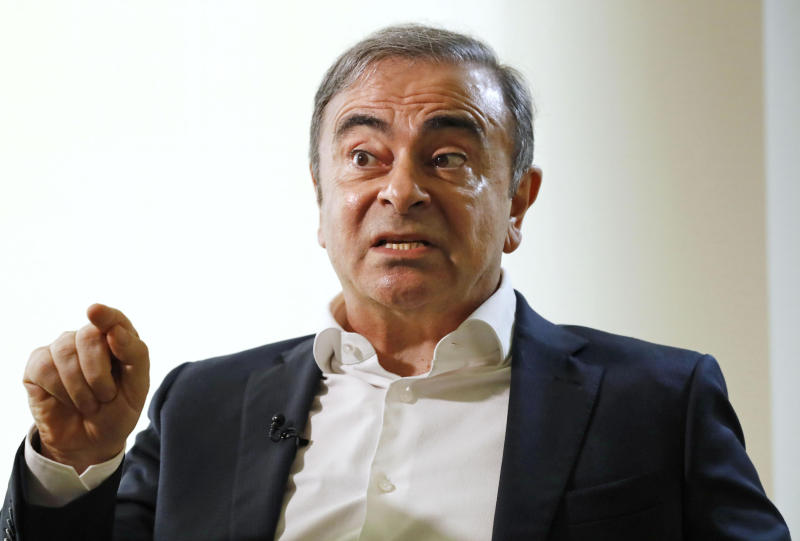 """Former Nissan Chairman Carlos Ghosn speaks to Japanese media during an interview in Beirut, Lebanon, Friday, Jan. 10, 2020. A lawyer for Carlos Ghosn, Nissan's former chairman who skipped bail in Japan and fled to Lebanon, on Friday slammed a gaffe by the Japanese justice minister who said that Ghosn should """"prove"""" his innocence.  Ghosn, who was awaiting trial on financial misconduct charges, fled Tokyo and appeared in Beirut Dec. 30. (Meika Fujio/Kyodo News via AP)"""