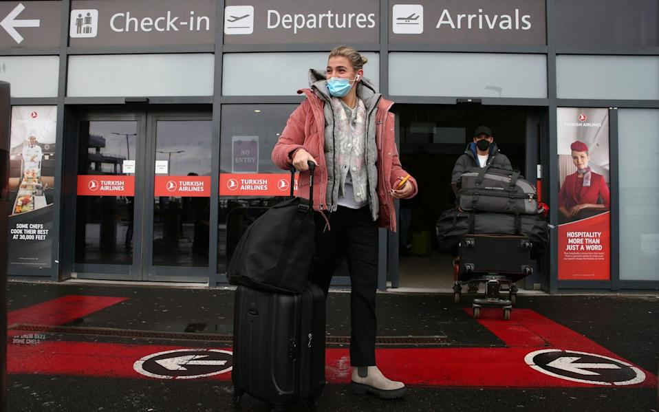Passengers after arriving at Edinburgh airport - Andrew Milligan/PA