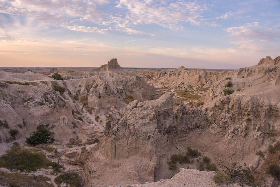 """<p>To truly experience Badlands National Park, go for a hike on the 1.5-mile <a href=""""https://www.tripadvisor.com/Attraction_Review-g143012-d144983-Reviews-Notch_Trail-Badlands_National_Park_South_Dakota.html"""" rel=""""nofollow noopener"""" target=""""_blank"""" data-ylk=""""slk:Notch Trail"""" class=""""link rapid-noclick-resp"""">Notch Trail</a> which snakes its way through a canyon and then you'll climb a ladder to view the White River Valley.</p><p><br><a class=""""link rapid-noclick-resp"""" href=""""https://go.redirectingat.com?id=74968X1596630&url=https%3A%2F%2Fwww.tripadvisor.com%2FAttraction_Review-g143012-d144983-Reviews-Notch_Trail-Badlands_National_Park_South_Dakota.html&sref=https%3A%2F%2Fwww.countryliving.com%2Flife%2Ftravel%2Fg24487731%2Fbest-hikes-in-the-us%2F"""" rel=""""nofollow noopener"""" target=""""_blank"""" data-ylk=""""slk:PLAN YOUR HIKE"""">PLAN YOUR HIKE</a></p>"""