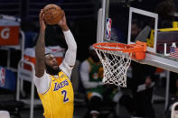 Los Angeles Lakers center Andre Drummond (2) goes up for a shot against the Utah Jazz during the first half of an NBA basketball game Monday, April 19, 2021, in Los Angeles. (AP Photo/Marcio Jose Sanchez)