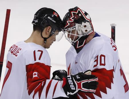 Ice Hockey – Pyeongchang 2018 Winter Olympics – Men Preliminary Round Match - Switzerland v Canada - Kwandong Hockey Centre, Gangneung, South Korea – February 15, 2018 - Rene Bourque (R) and goalkeeper Ben Scrivens of Canada celebrate after defeating Switzerland. REUTERS/Grigory Dukor