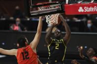 Oregon State's Roman Silva (12) tries to block a shot by Oregon's Eugene Omoruyi (2) during the second half of an NCAA college basketball game in Corvallis, Ore., Sunday, March 7, 2021. (AP Photo/Amanda Loman)