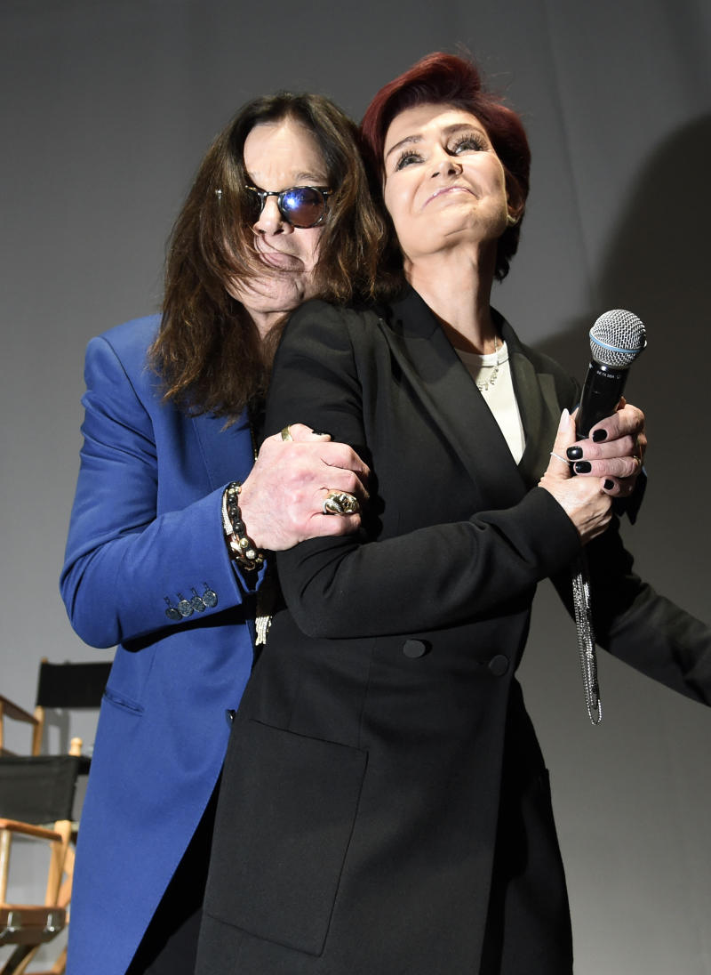 "Ozzy Osbourne, left, hugs his wife Sharon during the ""Ozzfest Meets Knotfest"" news conference at the Hollywood Palladium on Thursday, May 12, 2016, in Los Angeles. The multi-stage camping festival will be held on Sept. 24-25 at the San Manuel Amphitheater and Festival Grounds in San Bernardino, Calif. (Photo by Chris Pizzello/Invision/AP)"