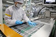 An employee works at a low dead space (LDS) syringe factory in Gunsan