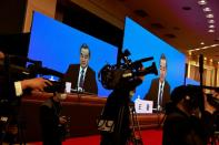 Chinese State Councillor and Foreign Minister Yi attends a news conference in Beijing