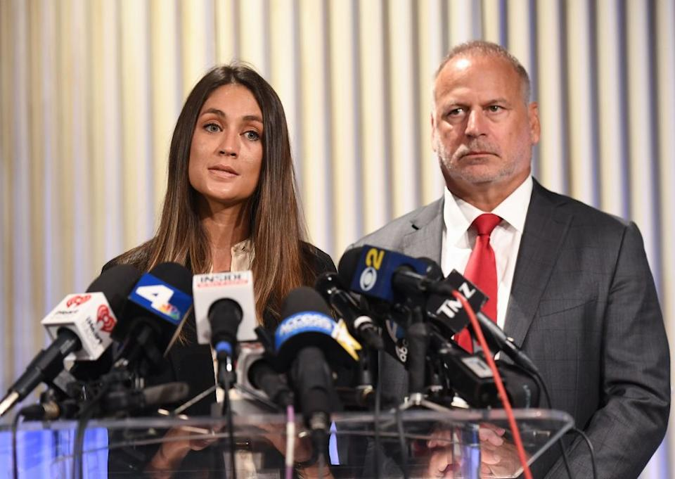 Dominique Huett and her attorney, Jeff Herman, speak about her lawsuit on Oct. 25, 2017. (Photo: MARK RALSTON/AFP/Getty Images)