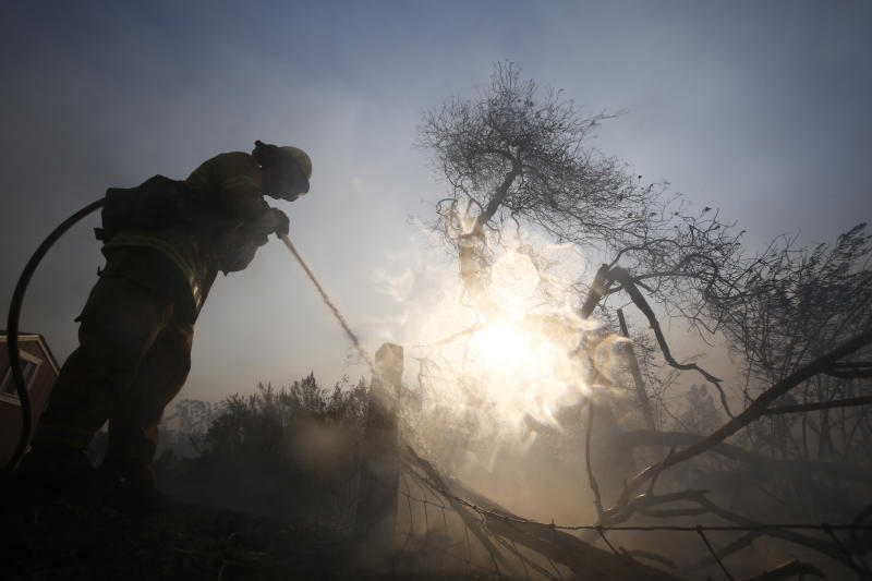 A firefighter battles a wildfire near a ranch in Simi Valley, Calif., Oct. 30, 2019. A large new wildfire has erupted in wind-whipped Southern California, forcing the evacuation of the Ronald Reagan Presidential Library and nearby homes. (Photo: Ringo H.W. Chiu/AP)