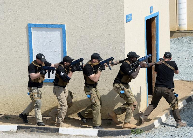 Security operatives train in a replica of part of the Somali capital Mogadishu at Poland's European Security Academy on April 24, 2015, which prepares people from around the world for missions in danger zones (AFP Photo/Janek Skarzynski)