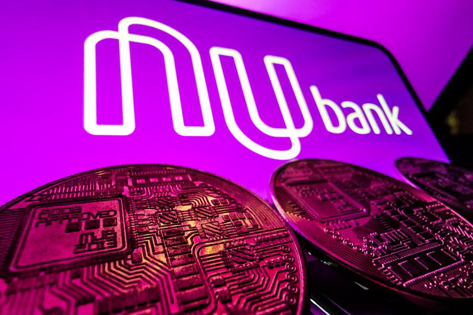 Representation of cryptocurrency and Nubank logo displayed on a phone screen are seen in this illustration photo taken in Krakow, Poland on August 17, 2021. (Photo by Jakub Porzycki/NurPhoto via Getty Images)