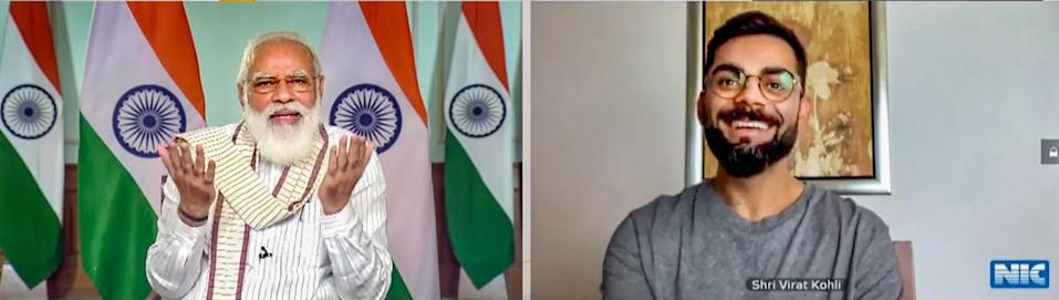 **EDS: SCREENSHOT FROM A VIDEO POSTED BY @narendramodi ON THURSDAY, SEPT. 24, 2020** New Delhi: Prime Minister Narendra Modi virtually interacts with Indian cricket team captain Virat Kohli during Fit India Dialogue on the first anniversary of Fit India Movement, in New Delhi. (PTI Photo)(PTI24-09-2020_000041B)